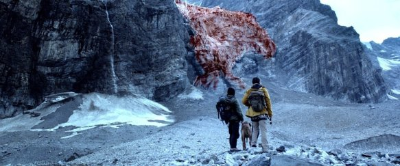 Scientists looking at the glacier